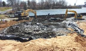 Removing and replacing soil at the Coast Guard Yard Superfund site.